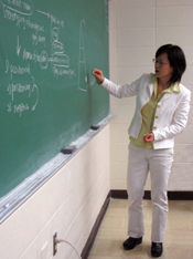 Professor Takeyama demonstrating a concept on the board