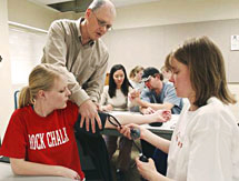 Students learning to take blood pressure